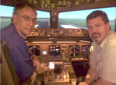 Sim sensation: Peter Spinks (left) has just landed a Boeing 777 at Melbournes Tullamarine Airport, after completing several aerial circuits in the simulator with Captain Ken Pascoe.